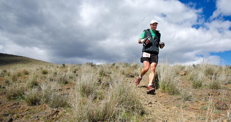 Adam Hewey, 50K first place finisher, on downhill #3.