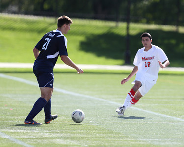 POUGHKEEPSIE, NY - SEPTEMBER 23: Anthony Rozmus #12 closes in on Milan Tica #21 during Yale verses Marist Soccer on September 23, 2012 at Tenney Stadium in Poughkeepsie New York.  Yale defeats Marist 2-1. (Photo by Sandy Tambone)