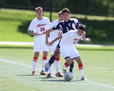 POUGHKEEPSIE, NY - SEPTEMBER 23: Anthony Rozmus #12, Evan Southworth #11, Connor Preece #30 of Marist Red Foxes and Yale Bulldogs Kevin Michalak #3 jockey for ball during Yale verses Marist Soccer on September 23, 2012 at Tenney Stadium in Poughkeepsie New York.  Yale defeats Marist 2-1. (Photo by Sandy Tambone)