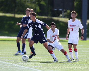 POUGHKEEPSIE, NY - SEPTEMBER 23: Pablo Espinola #6 moves ball while Anthony Rozmus #12 and Josh Faga #17 move oin to defend during Yale verses Marist Soccer on September 23, 2012 at Tenney Stadium in Poughkeepsie New York.  Yale defeats Marist 2-1. (Photo by Sandy Tambone)