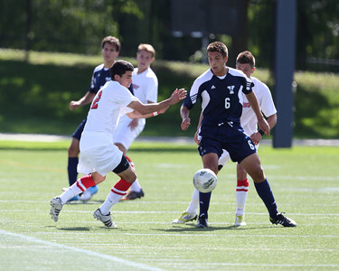POUGHKEEPSIE, NY - SEPTEMBER 23: Anthony Rozmus #12 move ball past Pablo Espinola #6 during Yale verses Marist Soccer on September 23, 2012 at Tenney Stadium in Poughkeepsie New York.  Yale defeats Marist 2-1. (Photo by Sandy Tambone)