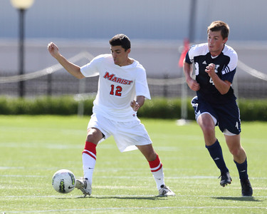 POUGHKEEPSIE, NY - SEPTEMBER 23: Anthony Rozmus #12 moves ball around Tony Wilbar #4 during Yale verses Marist Soccer on September 23, 2012 at Tenney Stadium in Poughkeepsie New York.  Yale defeats Marist 2-1. (Photo by Sandy Tambone)