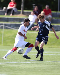 POUGHKEEPSIE, NY - SEPTEMBER 23: Stephen Brossard #9 move ball against Max McKiernan #5 during Yale verses Marist Soccer on September 23, 2012 at Tenney Stadium in Poughkeepsie New York.  Yale defeats Marist 2-1. (Photo by Sandy Tambone)