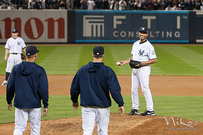 After Mo's last pitch at Yankee Stadium, Derek Jeter and Andy Pettitte walk to the mound.
