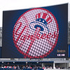 The new Yankee Stadium has a huge scoreboard.