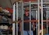 "Rodeo Bull breeder George Hempenstall demonstrates in his ""workshop"", the Rodeo cage he has constructed to be used during the open Bull Ride at Yass."