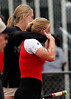 Karli Jelden wipes away a tear while sister-coach Kaelie hugs her after her 3A state Championship pole vault