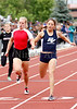 Platte Valley's Rachael Moralez just edges out Eaton's Aimee Ledall for 2nd place in the 200m dash at the State Track and Field Meet