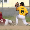 North Leominster player Nico Martinez slides safe into second as Leominster Nationals player Nick Garcia tried to get the throw. SENTINEL & ENTERPRISE/JOHN LOVE