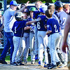 Teammates greet Leominster American's Dylan Sousa at home plate after hitting a home run during the Leominster Major League City Championship game against North Leominster on Friday evening. SENTINEL & ENTERPRISE / Ashley Green