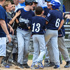 Leominster American's Tyler Carr is greeted by teammates at home plate after hitting a three-run home run. SENTINEL & ENTERPRISE / GARY FOURNIER