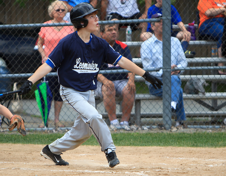 Leominster American's Tyler Carr watches the flight of his three-run home run during Saturday's Leominster Major League City Championship game at Justin DeSantis Field. American defeated Leominster National, 12-1, to force a winner-take-all title clash on Sunday. SENTINEL & ENTERPRISE / GARY FOURNIER
