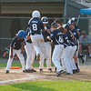 Leominster LL All-Star Nick Garcia jumps onto the plate while being greeted by his teammates after smashing a 3 run homer to put his team ahead 7-5 against Holden LL in a playoff game in Paxton. Holden rallied in the bottom of the 6th to beat Leominster 8-7. SENTINEL&ENTERPRISE/ Jim Marabello
