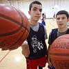 KEN YUSZKUS/Staff photo. Twins Max, left, and Marcus Zegarowski at the Hamilton-Wenham boys basketball practice.  01/12/15
