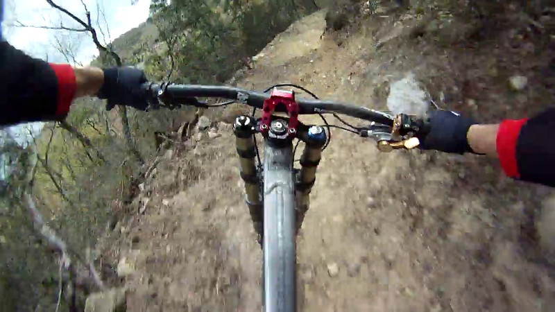 gopro footy of Sam Skidmore riding lower fire road into new section leading to final rock garden