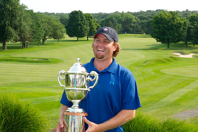 071312, Marblehead, MA - Mike Calef with his trophy after winning the Massachusetts Golf Association's Massachusetts Amateur Championship match at the Tedesco Country Club. Herald photo by Ryan Hutton