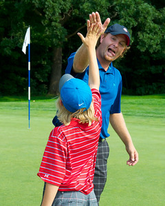 071312, Marblehead, MA - Mike Calef high fives a young spectator after winning the Massachusetts Golf Association's Massachusetts Amateur Championship match at the Tedesco Country Club. Herald photo by Ryan Hutton