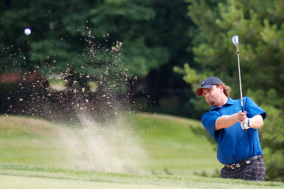 071312, Marblehead, MA - Mike Calef digs his way out of a bunker at the 9th hole of the Tedesco Country Club during the Massachusetts Golf Association's Massachusetts Amateur Championship match. Herald photo by Ryan Hutton