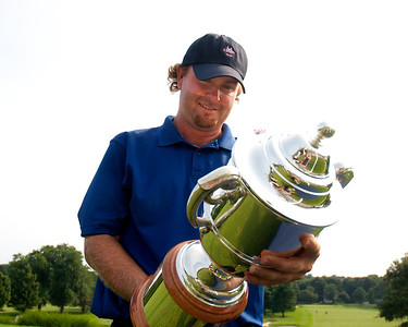 071312, Marblehead, MA - Mike Calef admires his trophy after winning the Massachusetts Golf Association's Massachusetts Amateur Championship match at the Tedesco Country Club. Herald photo by Ryan Hutton