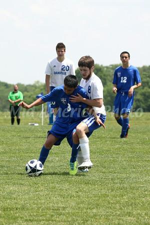 Danville/New London's Josh Deggendorf (#20), Bryon McCannon (#8) and Columbus' Eric Cantarero (#8) and Eric Ayala (#12)