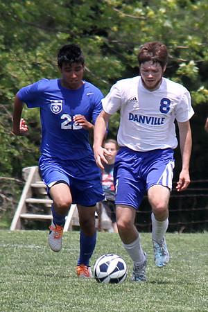 Danville/New London's Bryon McCannon (#8) and Columbus' Alejandro Hernandez (#22)