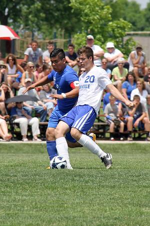 Danville/New London's Josh Deggendorf (#20) and Columbus' Bryan Santiago (#7)