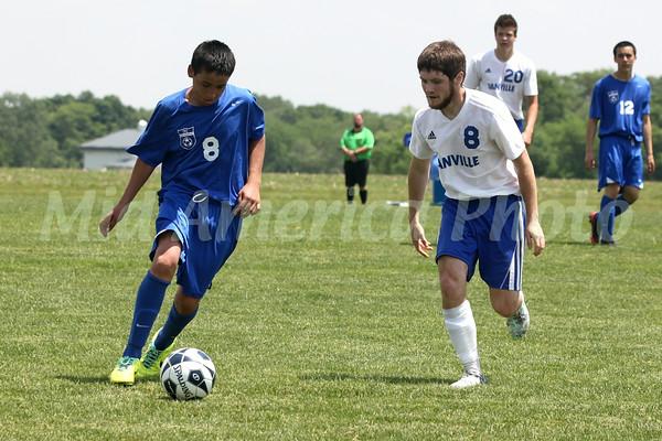 Danville/New London's  Bryon McCannon (#8), Josh Deggendorf (#20) and Columbus' Eric Cantarero (#8) and Eric Ayala (#12)