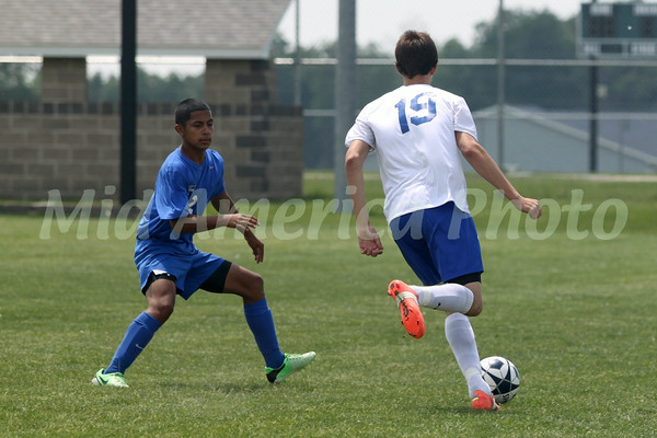 Danville/New London's Kole Perkins (#19) and Columbus' Adrian Santos (#2)