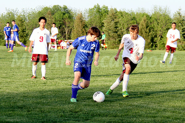 Danville/New London's Dalton McClurg (#2) and Mt. Pleasant's (#9), Brad Martin (#4) and Marco Torres (#24)