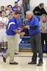 Coach Ken Laffoon received a plaque from Superintendent Gary DeLacy commemorating Laffoon's 400th career victory.