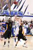 Danville's Shae Seils (#14) and Central Lee's Reed Shockley (#4) and Rick Galle (#30)
