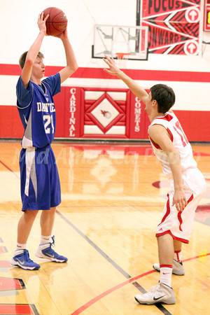 Danville's Dylan Criswell (#21) and Cardinal's Sam Pedersen (#10)