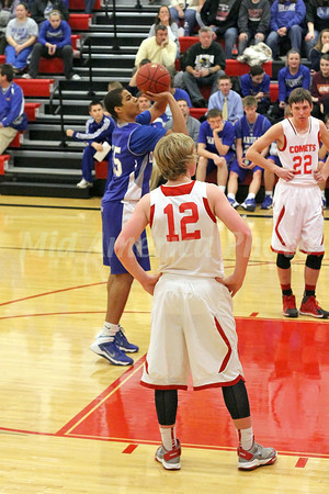 Danville's Bryton Rice (#15) and Cardinal's Cody Streeby (#12) and Charlie Rachford (#22)