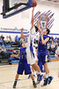 Danville's Kolton Jackson (#30) and Holy Trinity's Sam Harmeyer (#33) and Tanner Kelch (#35)