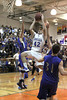 Danville's Connor Hoelzen (#42) and Holy Trinity's Blake Hellweg (#13) and Colin Kassmeyer (#31)