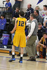 Notre Dame's Jeff Giannettino (#12) talking to the coach after getting his 5th foul.