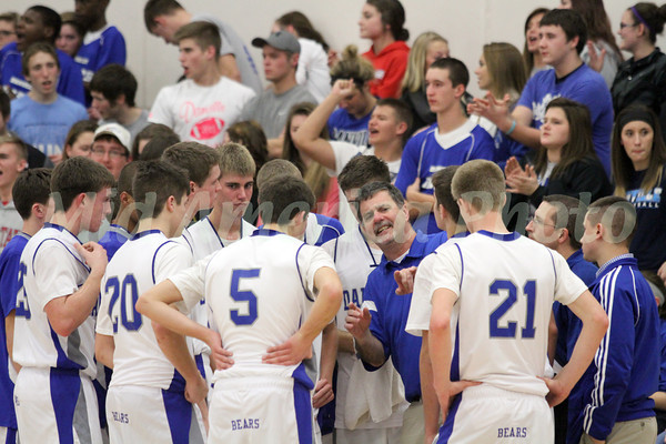 Danville's Coach Ken Laffoon giving constructive criticism to his team during a timeout.