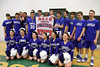 The Danville basketball team and the cheerleaders pose with their State Qualifier banner.