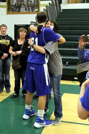 Danville's Dillon Sanchez (#21) hugs his mom after the game.