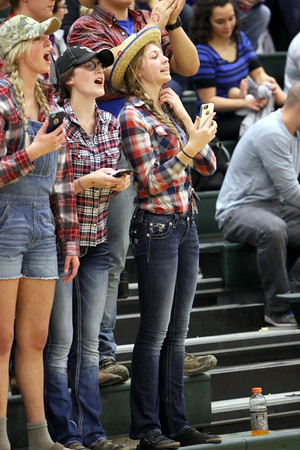 Danville's Emma Jarrett, Alexis Bauer, and McKenzie Speer show off their team spirit by dressing up in redneck attire.
