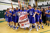 The Danville basketball team yells with excitement at the thought of going back to State.