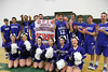 The Danville basketball team and the cheerleaders cheer while posing with their State Qualifier banner.