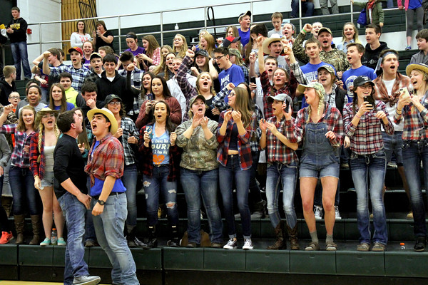 The Danville student section celebrates the basketball team's win.
