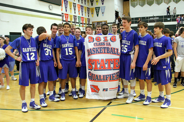 The Danville basketball team poses with their State Qualifier banner.