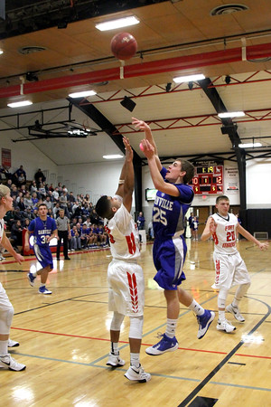 Danville's Bryce Carr (#25) and Fort Madison's CJ Richardson (#10)