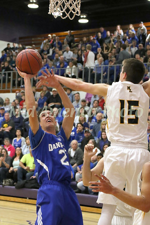 Danville's Kole Perkins (2) is fouled by New London's Alex Dentlinger (15) February 23, 2017 in the Class 1A, District 10 final on Don Gibbs Court, Carl Johannsen Gymnasium in Burlington.<br /> Photo by Donald K. Aliprandi