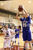 Danville's Kaleb Haeffner (35), IMS' Caleb Gingrich (15) and Mitchell Schneider (30) {who blocked the shot}