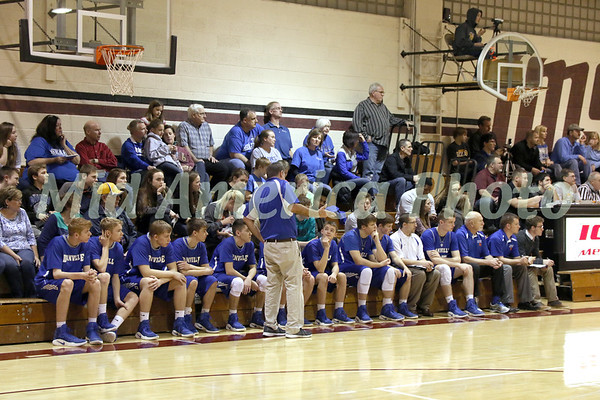 Danville's coach Ken Laffoon giving instruction to Elijah Svoboda (3) while the rest of the bench watches the game.