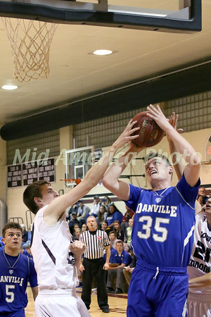 Danville's Kaleb Haeffner (35) has his shot blocked by IMS' Mitchell Schmieder (30) Friday, February 10, 2017 at Iowa Mennonite School in Kalona.<br /> Photo by Donald K. Aliprandi