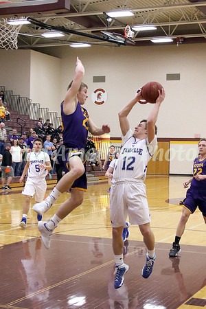 Danville's Bryce Carr (12) puts up a shot defended by Keota's Jacob Wickenkamp (23) February 21, 2017 in the Class 1A, District 10 semifinal at Mt. Pleasant.<br /> Photo by Donald K. Aliprandi
